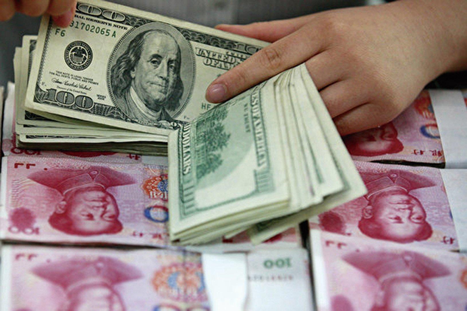 中共央行取消「兩金」,開始抑制人民幣升勢。(大紀元資料室)