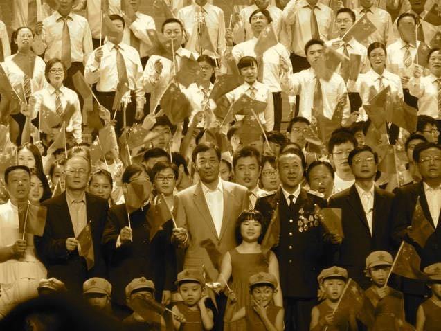 劉長樂與薄熙來一起唱紅歌。(文心社網站擷圖)