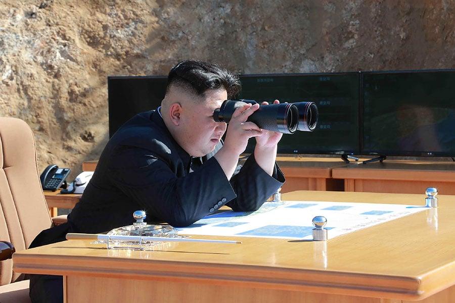 金正恩堅持特金會在平壤舉行,被美國否決。(STR/AFP/Getty Images)