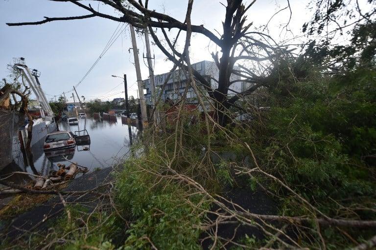 9月21日波多黎各的聖胡安水淹的街道。(AFP PHOTO / HECTOR RETAMAL)