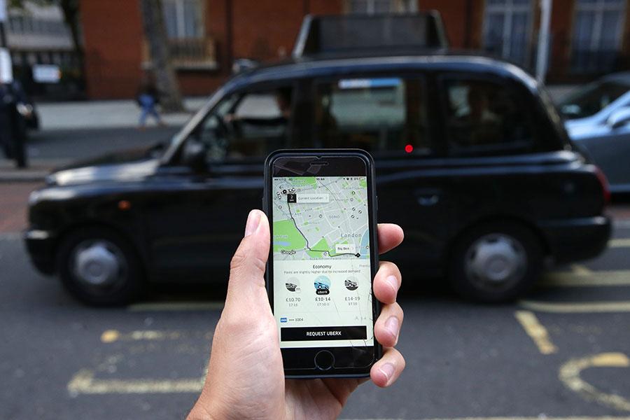 倫敦將不再給Uber續執照。(DANIEL LEAL-OLIVAS/AFP/Getty Images)