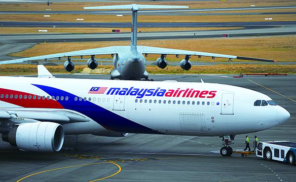 2014年3月8日,馬來西亞航空由吉隆坡飛往北京的MH370航班在起飛一小時後,在越南上空突然消失。(Greg Wood - Pool/Getty Images)