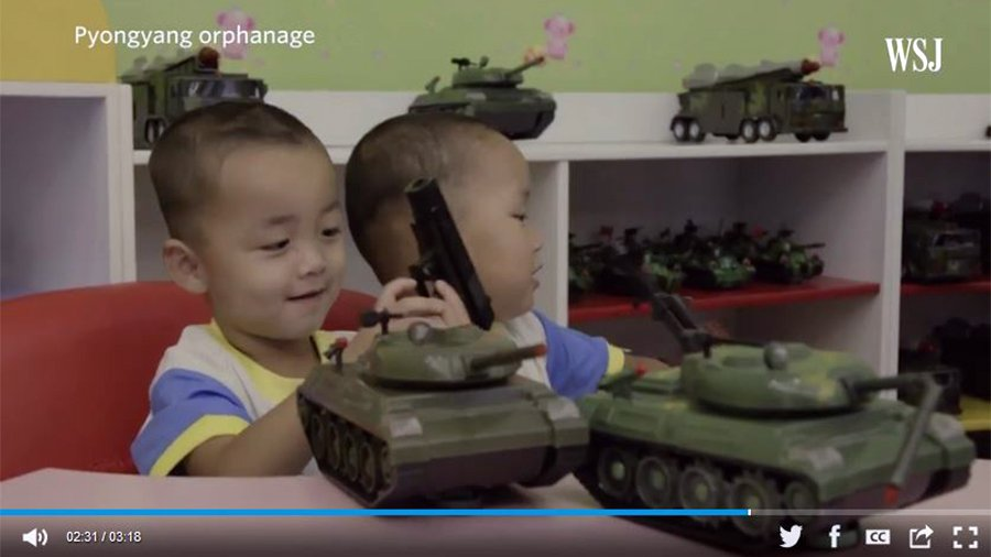 在一所孤兒院裏,孩子們的玩具車不是小卡車,而是塑料做的火箭發射車。(華爾街日報視像擷圖)