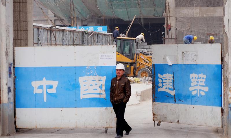 因對樓市的調控收效不大,中共十九大後或將對樓市進行調控。圖為北京一處工地。(Franko Lee/AFP/Getty Images)