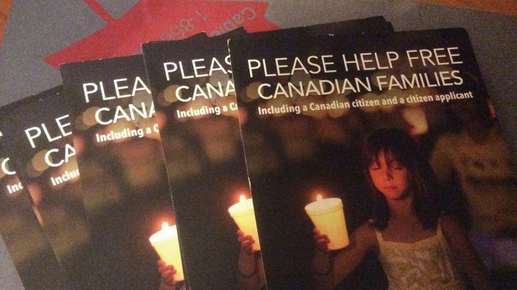 加拿大法輪功學員為營救學員親屬徵簽的明信片(新唐人)