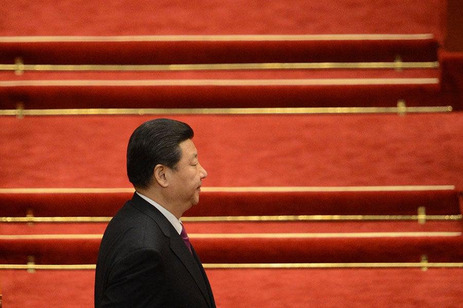 著名政論家胡平先生稱,習近平化解了十九大上的一個大危機。(AFP PHOTO/GOH CHAI HIN)