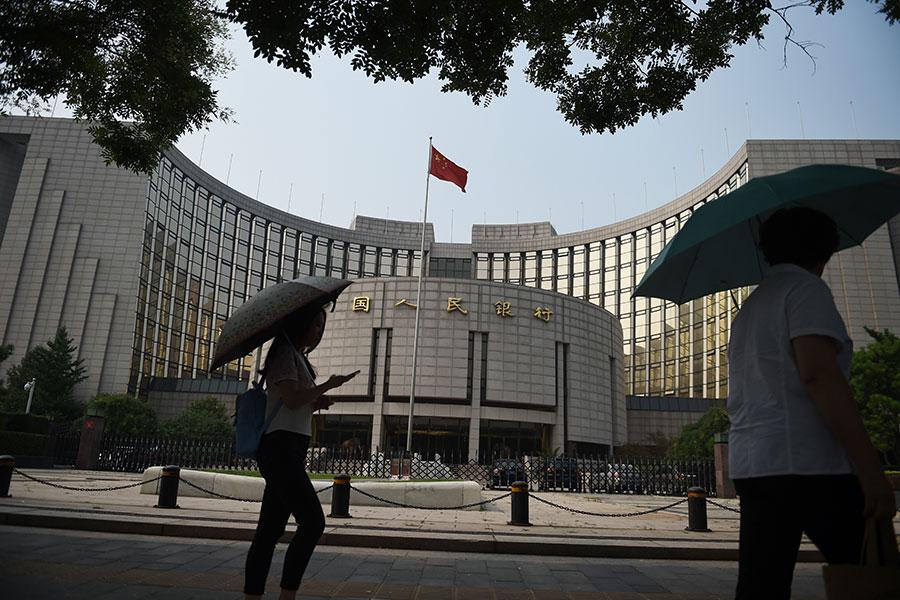 專家認為,大陸地方政府債務高築,「中國金融泡沫成長難以想像」。(GREG BAKER/AFP/Getty Images)