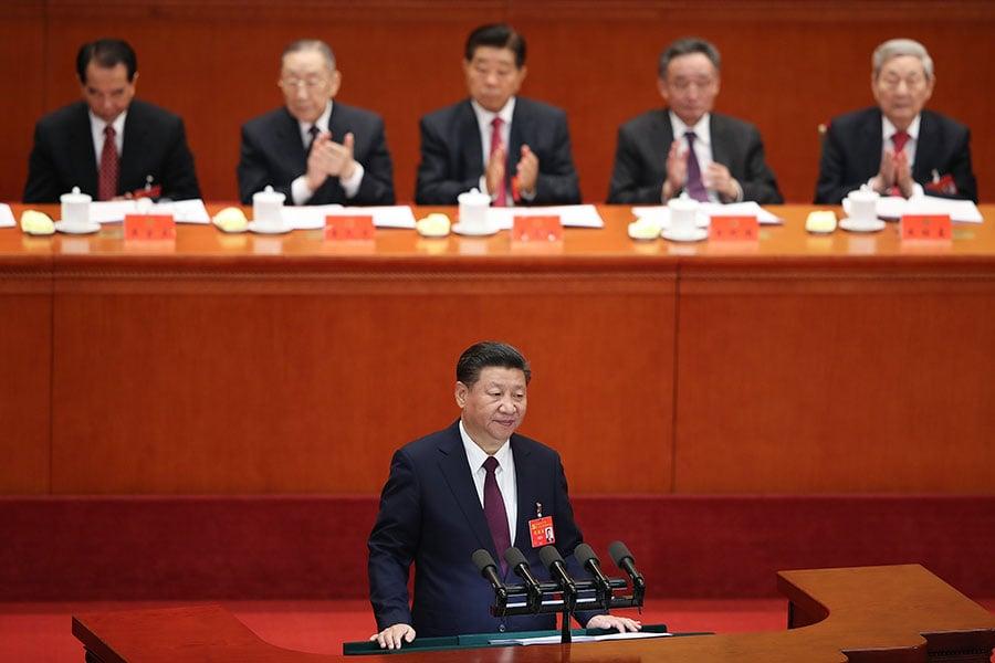 圖為10月18日,習近平在開幕上宣讀十九大報告。(Lintao Zhang/Getty Images)