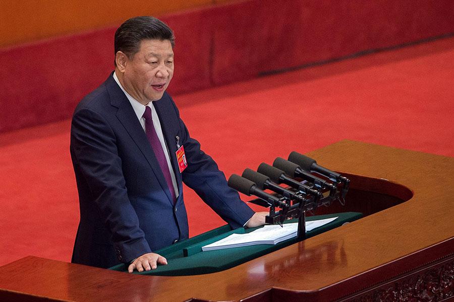 中共十九屆二中全會上,將修改憲法,中共國家主席任期制是否修改引外界關注。圖為習近平在中共十九大上作報告。(NICOLAS ASFOURI/AFP/Getty Images)