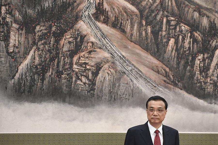李克強10月25日連任常委後,他主管的國務院高層人事將在明年的中共兩會上進行大換血。(WANG ZHAO/AFP/Getty Images)