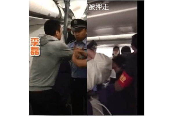 李磊與妻子拒絕下機,情緒激動,被強制帶走。(視像擷圖)