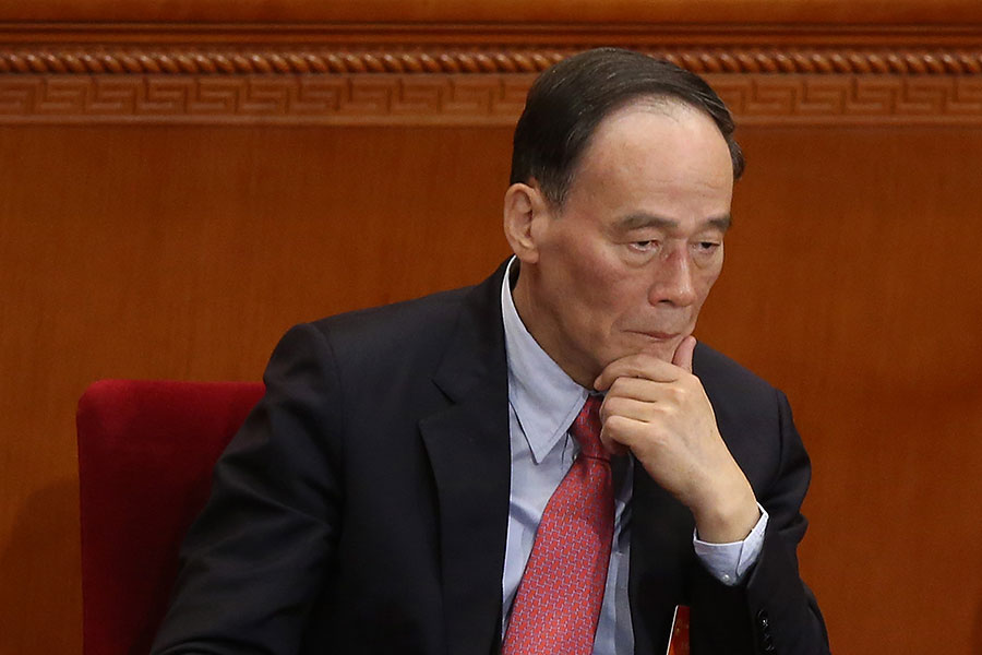 王岐山未進入中共十九大「兩委」名單,有分析認為,他還有未竟的事情要做。(Feng Li/Getty Images)
