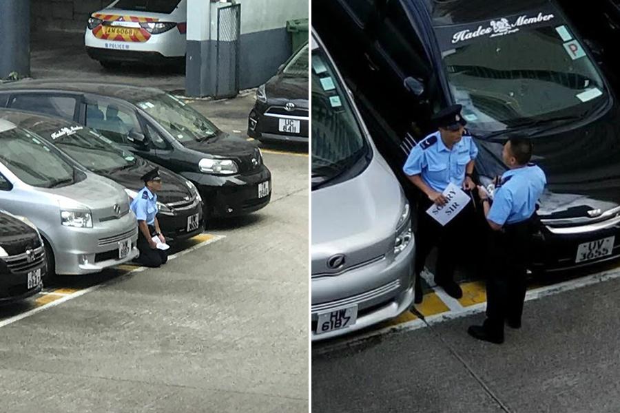 今日(7日)網傳多張昨日拍攝的照片,一名男警於觀塘警署停車場跪地高舉「SORRY SIR」紙牌,疑正在向新上任的警司表達訴求,照片引發網民熱議。(網絡圖片)
