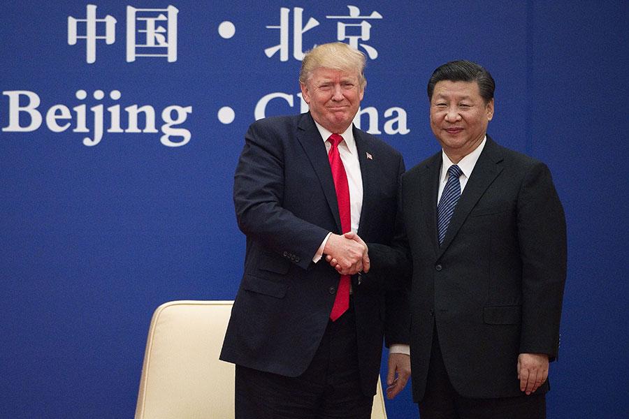 特朗普與習近平今日上午在人民大會堂出席中美企業家對話會。(NICOLAS ASFOURI/AFP/Getty Images)
