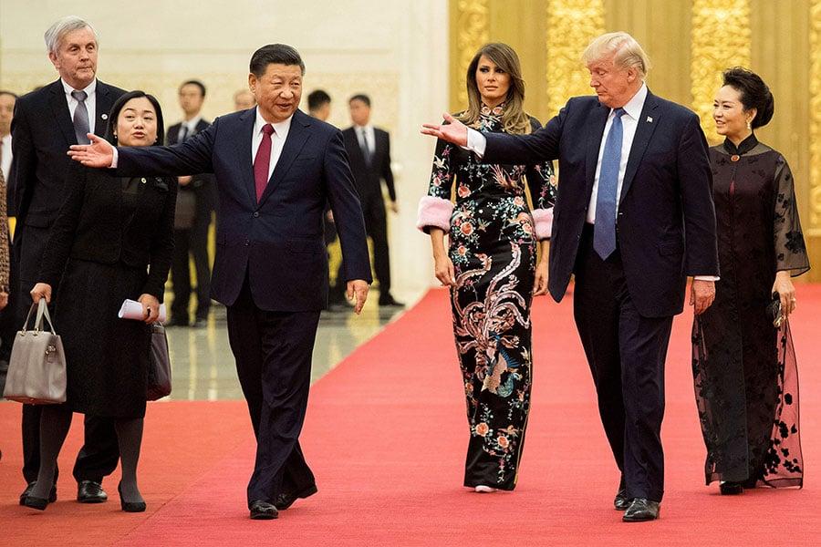 美國總統特朗普先後與習近平、中美企業家及李克強進行了會談。(JIM WATSON/AFP/Getty Images)