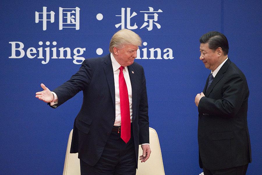 美國總統特朗普答應將要和金正恩會面後,與中國國家主席習近平通電話。(NICOLAS ASFOURI/AFP/Getty Images)