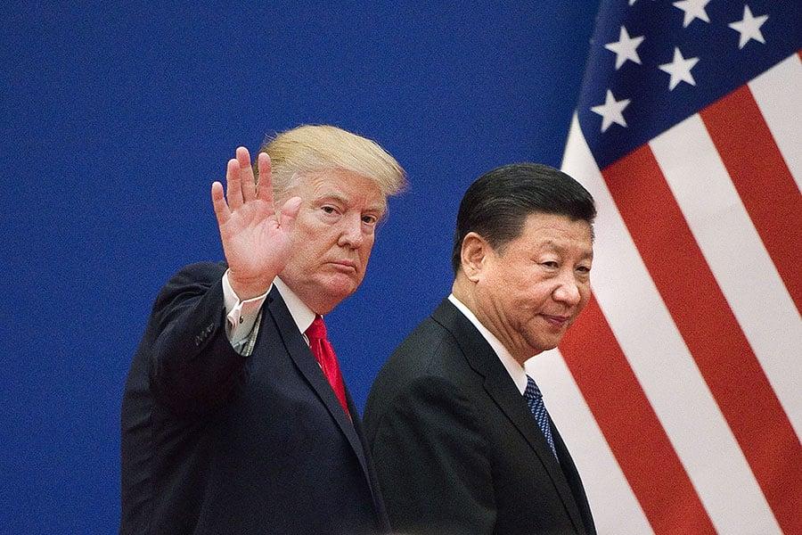 圖為2017年11月9日,國家主席習近平與美國總統特朗普在北京會晤。(NICOLAS ASFOURI/AFP/Getty Images)