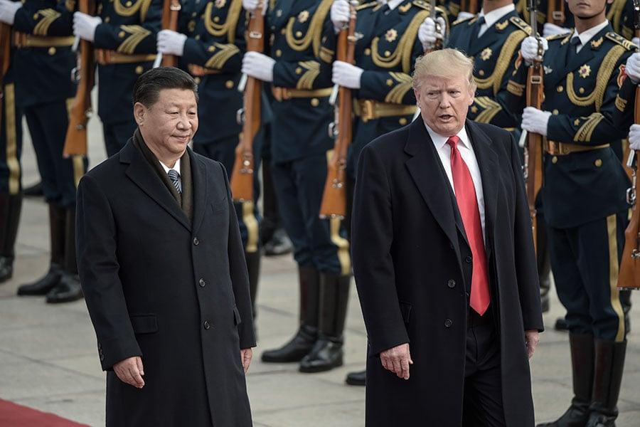 圖為特朗普訪華與習近平會晤。(AFP PHOTO/FRED DUFOUR)