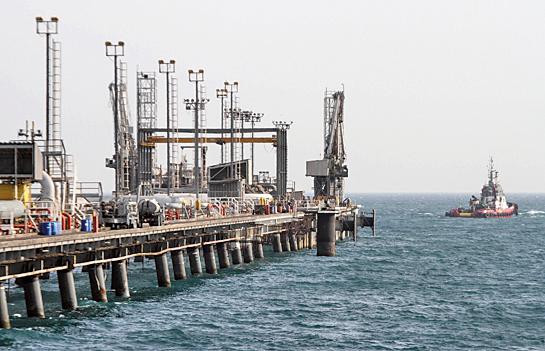 國際油價19日收盤上揚,主因科威特石油工人罷工進入第三天,激發全球原油供應過剩情況可能緩和的希望。圖為伊朗一石油提煉中心。(AFP/Getty Images)