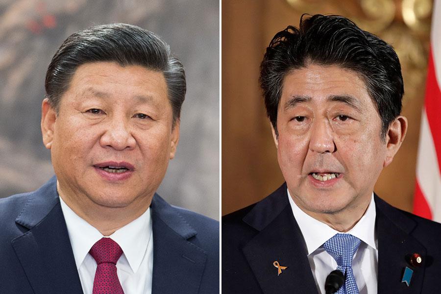 圖為習近平(左)與安倍晉三。(Lintao Zhang, KIYOSHI OTA/AFP/Getty Images)