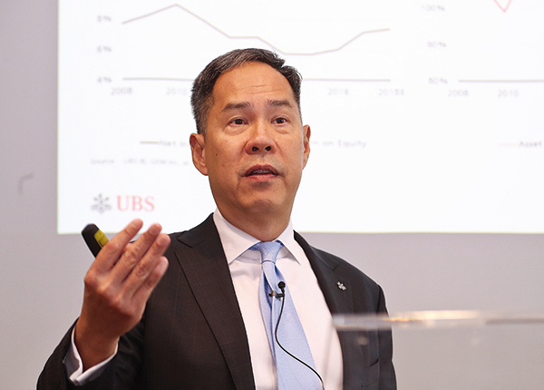 瑞銀資產管理環球經濟新興市場與亞太區股票主管黃義旗表示,現階段不宜太早評論會港股所受影響,相信措施只影響某部分基金表現。(余鋼/大紀元)