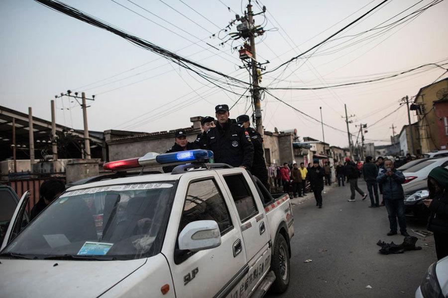 北京驅逐行動引發多重問題 美雜誌編輯也被逐