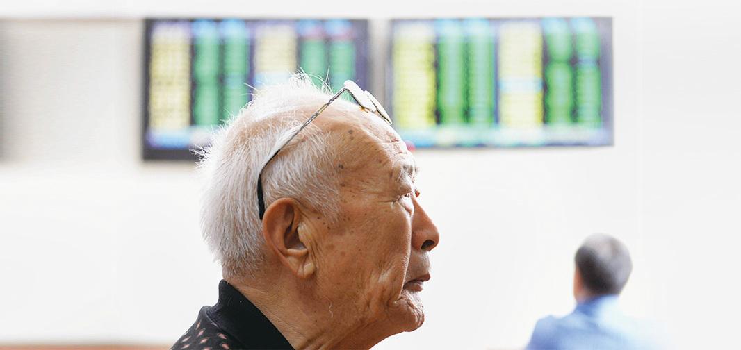 最大新興市場之一的中國,在2017年全球股市的一片快漲聲中落單,11個月來上證、深證指數累計上漲幅度不到8%。(Getty Images)