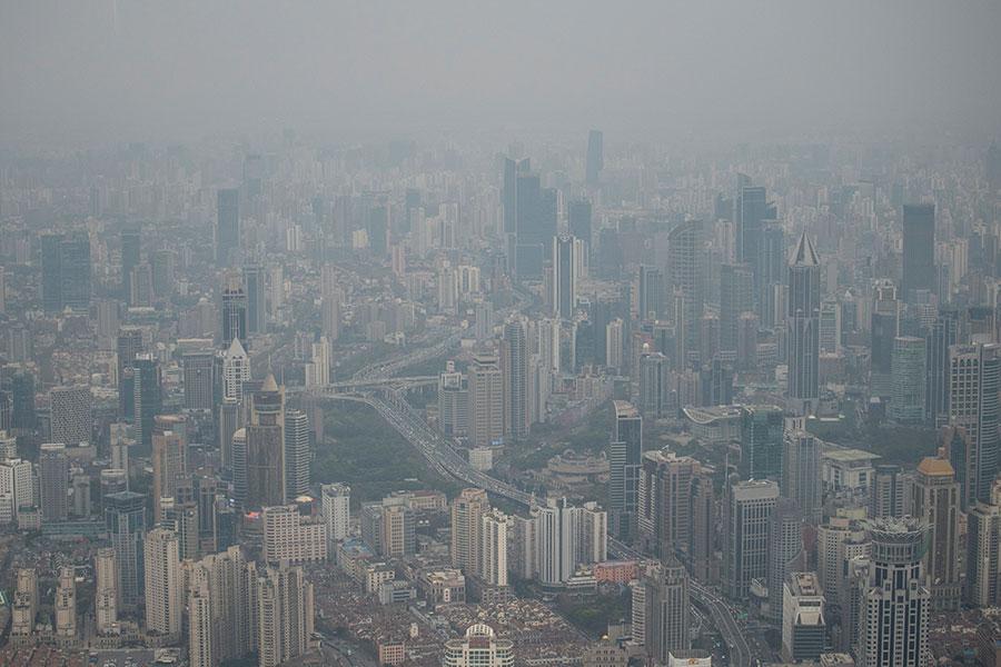上海「東八塊」,其中2塊被江澤民兩個兒子收入曩中。(JOHANNES EISELE /AFP/Getty Images)
