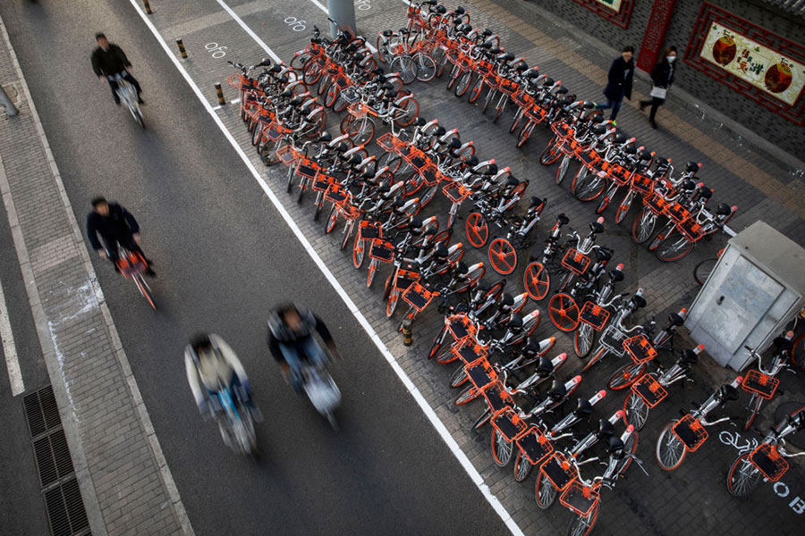 圖為北京街頭的共享單車租賃服務點。(Kevin Frayer/Getty Images)