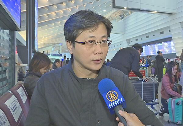 李忠原在台灣桃園機場接受採訪。他是在去年8月器官移植協會(TTS)國際大會期間,來港向與會者和市民講述中共迫害法輪功和活摘器官的真相,期間遭青關會成員誣告。(新唐人電視台截圖)