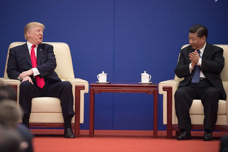 美國駐華大使透露,總統特朗普上個月首度訪華期間,雖然和中國國家主席習近平互動良好,但是在中美貿易問題上並不手軟。(NICOLAS ASFOURI/AFP/Getty Images)