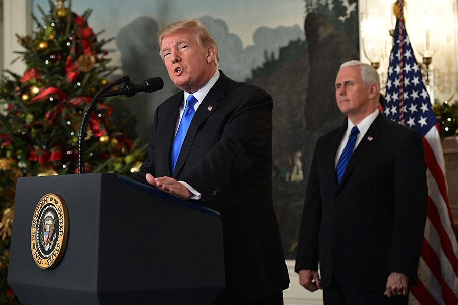 耶路撒冷問題是美國前幾任總統20多年來一直未敢去兌現的承諾,終被上任不到一年的特朗普兌現。(AFP PHOTO / MANDEL NGAN)