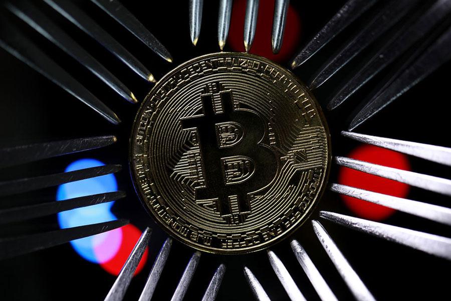 比特幣近期價格暴漲,有專家警告,北韓政權支持的黑客已經瞄準了比特幣市場,圖謀獲取經濟利益。(Dan Kitwood/Getty Images)