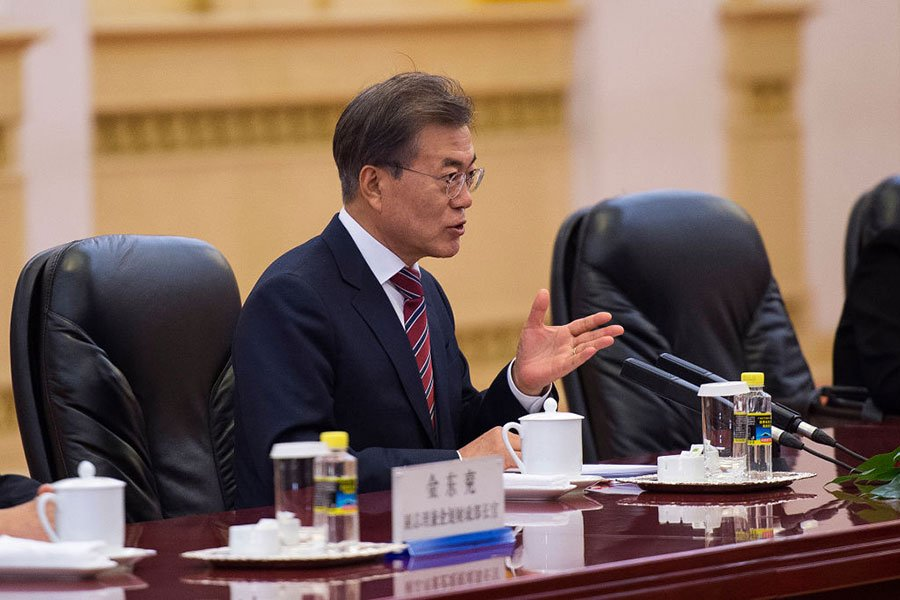 南韓媒體覺得文在寅的國是訪問,被怠慢、降格了。(NICOLAS ASFOURI/AFP/Getty Images)