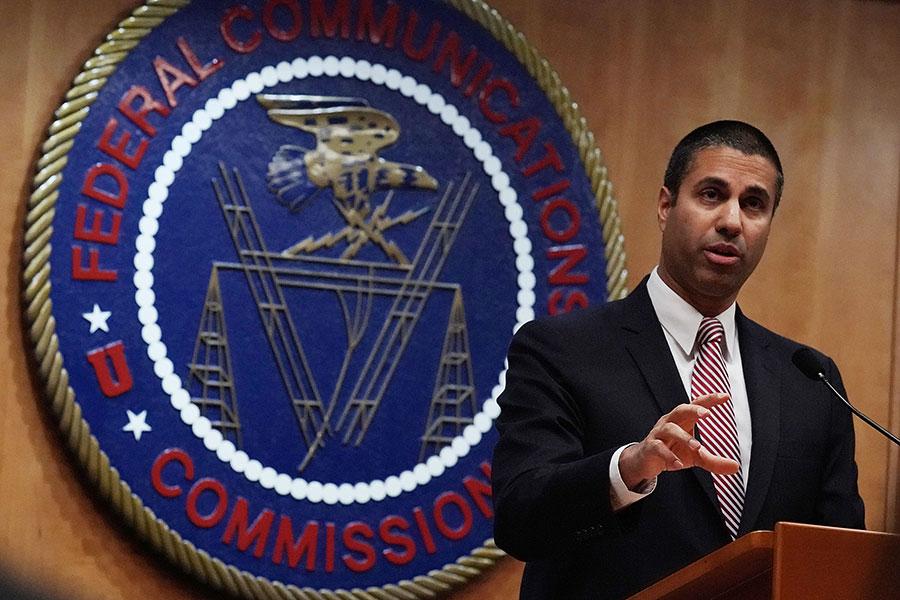 美聯邦通訊委員會(FCC)12月自廢「網絡中立」規定,敢於卸下手中權力的做法,贏得網民的理解和支持。(Alex Wong/Getty Images)892859738