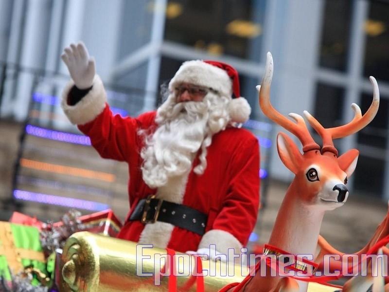堪薩斯市的神秘聖誕老人又來了,這次是在堪薩斯州首府托皮卡(TOPEKA),向該地貧困地區的陌生人派發百元美鈔。圖為聖誕老人資料圖。(伊田/大紀元)