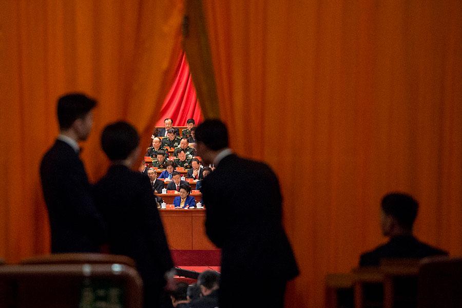 隨著去年中共十九大的高層換屆及本次中共兩會高層人事變動,中共國安委10多人也料將隨之被撤換。(FRED DUFOUR/AFP/Getty Images)