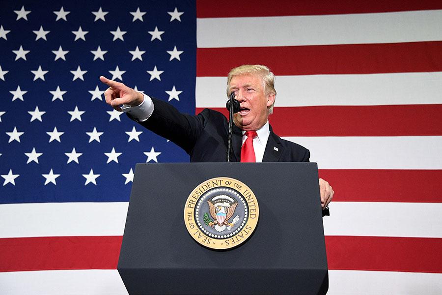 美國稅改本月成為法律,它受到特朗普總統和其他共和黨領袖的倡導,以提高美國的全球競爭力。(JIM WATSON/AFP/Getty Images)840966232