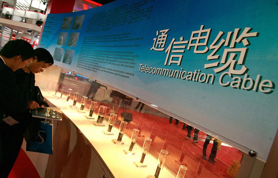 中國公司推銷電纜產品。(TEH ENG KOON/AFP/Getty Images)