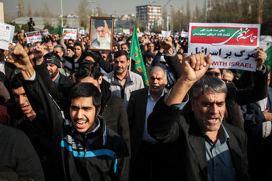 伊朗近日發生大規模示威,已有12名示威者被殺及數百人被捕。(HAMED MALEKPOUR/AFP/Getty Images)