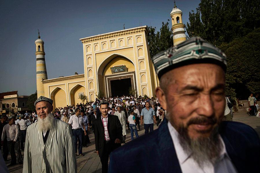維族人不斷被中共以「恐怖份子」的名義打擊。2009年,他們開始清醒,「我們必須凝聚起來,自己保護自己」。(Kevin Frayer/Getty Images)