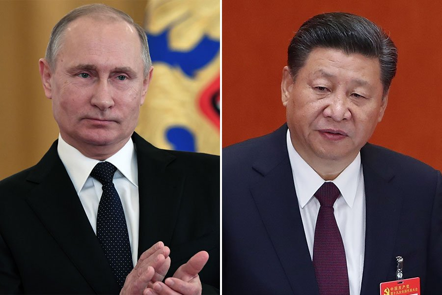 日前北韓官媒報道金正恩收到新年賀卡時,再次將俄羅斯總統普京(左)排在習近平(右)之前。(Lintao Zhang, KIRILL KUDRYAVTSEV/AFP/Getty Images/大紀元合成)