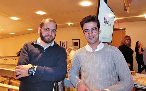 Elie Abou Assaf神父(右)和友人。Elie Abou Assaf神父表示,神韻的音樂將他的靈魂帶到了不同的境界。(滕冬育/大紀元)