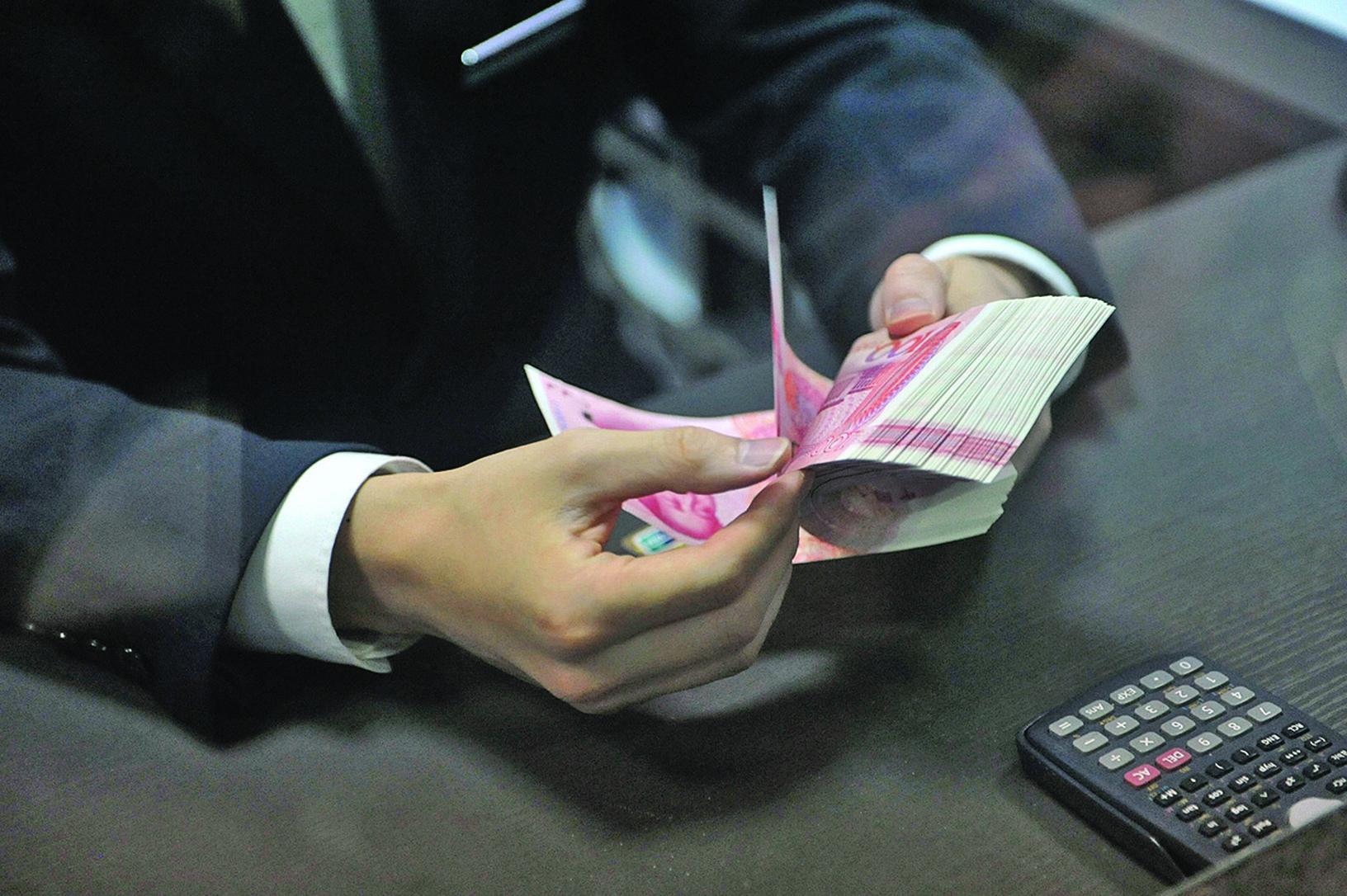 中共用開動印鈔機來應付高負債。(Getty Images)