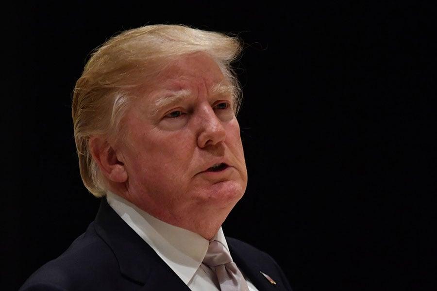 在美朝首腦會談落幕之後,美國總統特朗普發推文說,美國已經排除了北韓核武威脅,而該國現階段最大的敵人則是「假新聞」。(NICHOLAS KAMM/AFP/Getty Images)