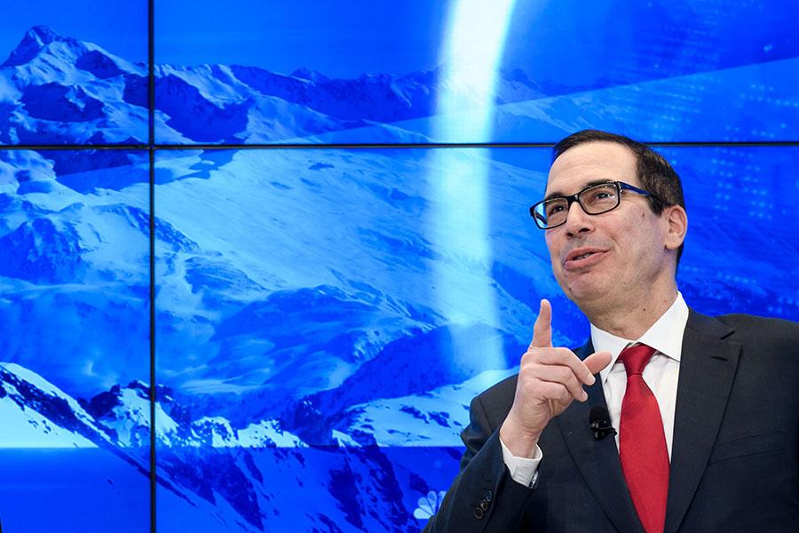 美國財政部部長姆欽(Steven Mnuchin)周三(1月24日)在達沃斯世界經濟論壇(WEF)舉行新聞發佈會,透露美國優先重要信息。(FABRICE COFFRINI/AFP/Getty Images)
