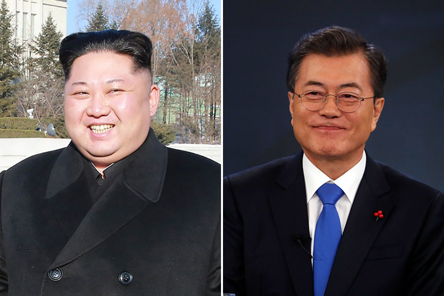 北韓朝中社刊文呼籲,改善南北韓之間的關係,尋求朝鮮半島的統一。圖為北韓領導人金正恩(左)與南韓總裁文在寅。(KIM HONG-JI, STR/AFP/Getty Images)