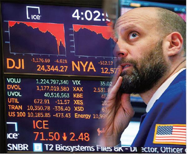 2月5日紐約證券交易所內的工作人員。(大紀元資料室)