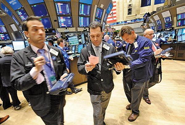 美股週二在科技股的強勢反彈下獲得喘息,道指大漲567點。(STAN HONDA/AFP/Getty Images)