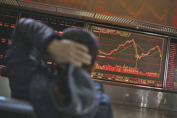 大陸股市本周下跌了9.6%。圖為2月7日北京的一個股票交易廳。(AFP)